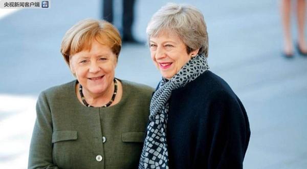 英首相特雷莎·梅就延期脱欧与德国总理默克尔会谈